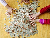 Children counting money on the floor