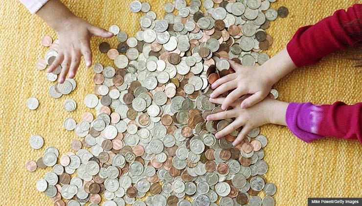 Children counting money on the floor