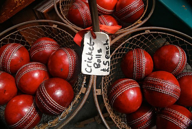 Red cricket balls in thrift store, frugal holiday season