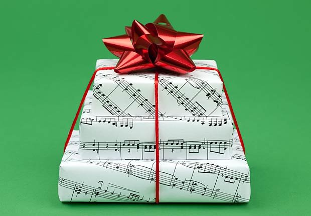 Gifts wrapped in sheet music, frugal holiday season