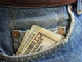 Money sticking out jeans pocket, Managing your money quiz