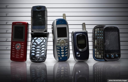 Line-up of old cell phones