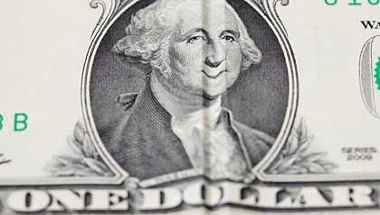 Un billete de dólar - 10 maneras de ahorrar dinero sin dolor