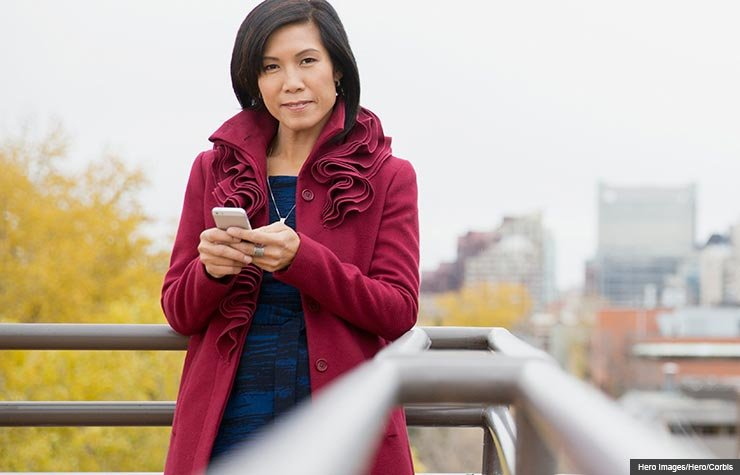 Woman on rooftop patio, Changing your cell phone carrier