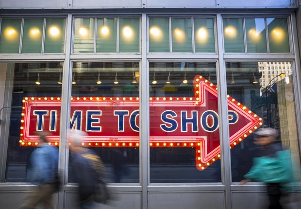 Shopping sign in store window (Pgiam/Getty Images)