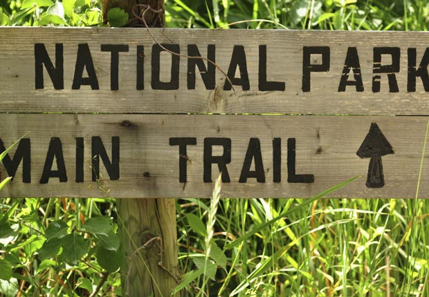 National Park sign in grass (Andrew DeCrocker/Istockphoto)