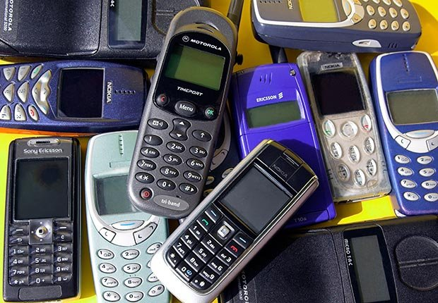Collection of old cell phones. 10 spending regrets.