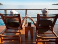 Couple relaxing in an over water bungalow (Getty Images)