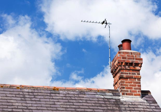 Check chimney for cracks.  $100 or less DIY home fixes. (Incamerastock/Alamy)
