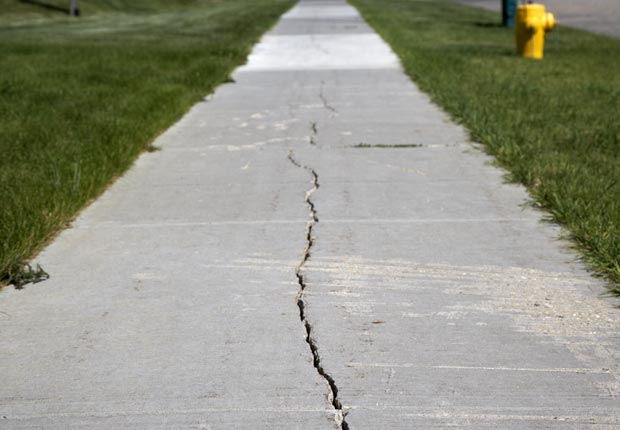 Fix cracks in driveway and sidewalks.  $100 or less DIY home fixes. (Joe Fox/Getty Images)