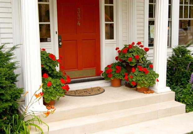 Give your front door a fresh coat of paint. $100 or less DIY home fixes. (Chuck Eckert/Alamy)