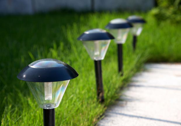 Solar landscaping lights.  $100 or less DIY home fixes. (Radharc Images/Alamy)