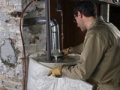 Install a hot water heater insulation blanket. (Istockphoto)