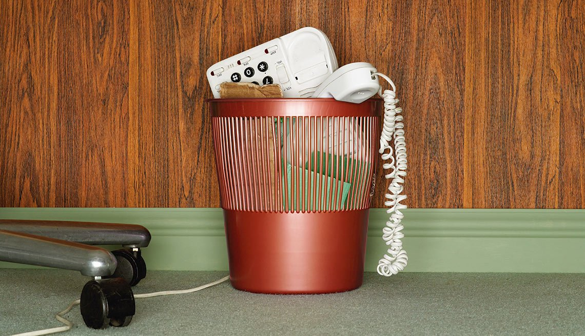 Phone in waste basket. Should you drop your landline?