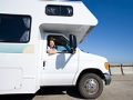 Woman in sunglasses in motor home, Buying a Used R (Juice Images/Corbis)