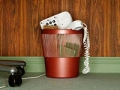 Phone in waste basket. Should you drop your landline? (Laurence Dutton/Getty Images)