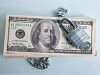 Stack of money with lock. Economic Security (Steve Lewis/Getty Images)