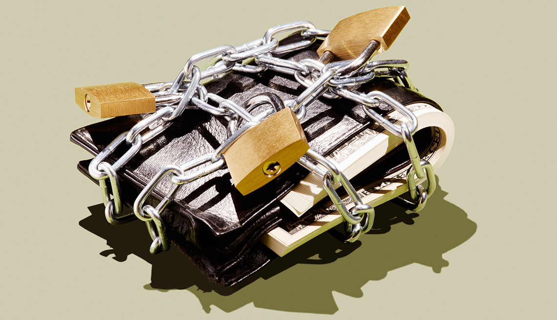 Wallet locked in chains and padlocks
