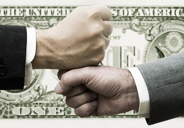 Two businessmen bump fists, Business loans are bad to co-sign