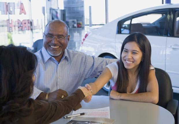 Father and daughter buying car, Car loans are bad to co-sign