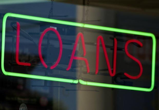 Neon loans sign, Payday loans are bad to co-sign