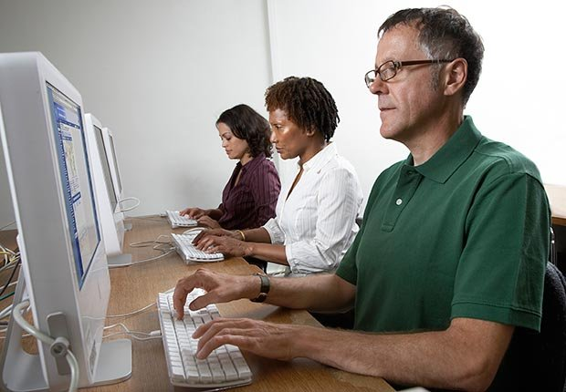 Man uses a public computer to check account information.