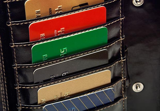 Several credit cards in wallet (Photoblink/Istockphoto)