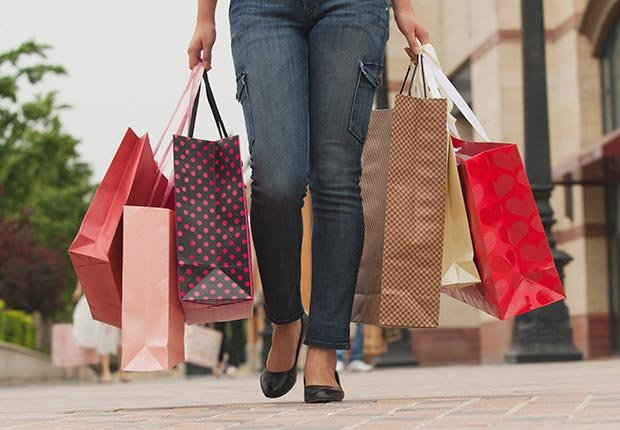 Woman carrying shopping bags (Jade/Blend Images/Corbis)