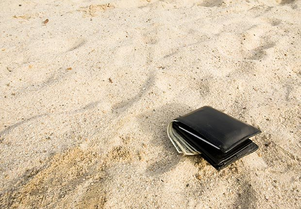 Wallet dropped in the sand. (Charles Silvey/Istockphoto)