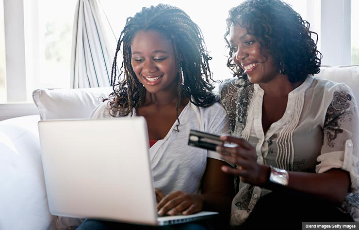 Mother and daughter shopping online with credit card, Help Your College Student to Develop Credit Card Smarts (Blend Images/Getty Images)