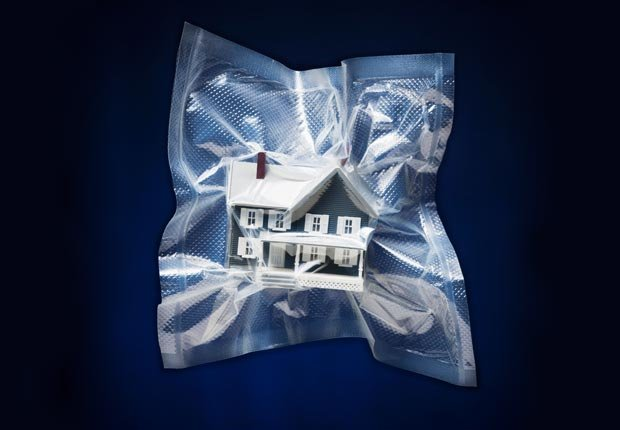 Poor credit can affect your homeowners insurance. (Tetra Images/Alamy)