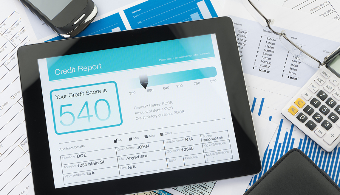 A tablet with someone's credit score on it