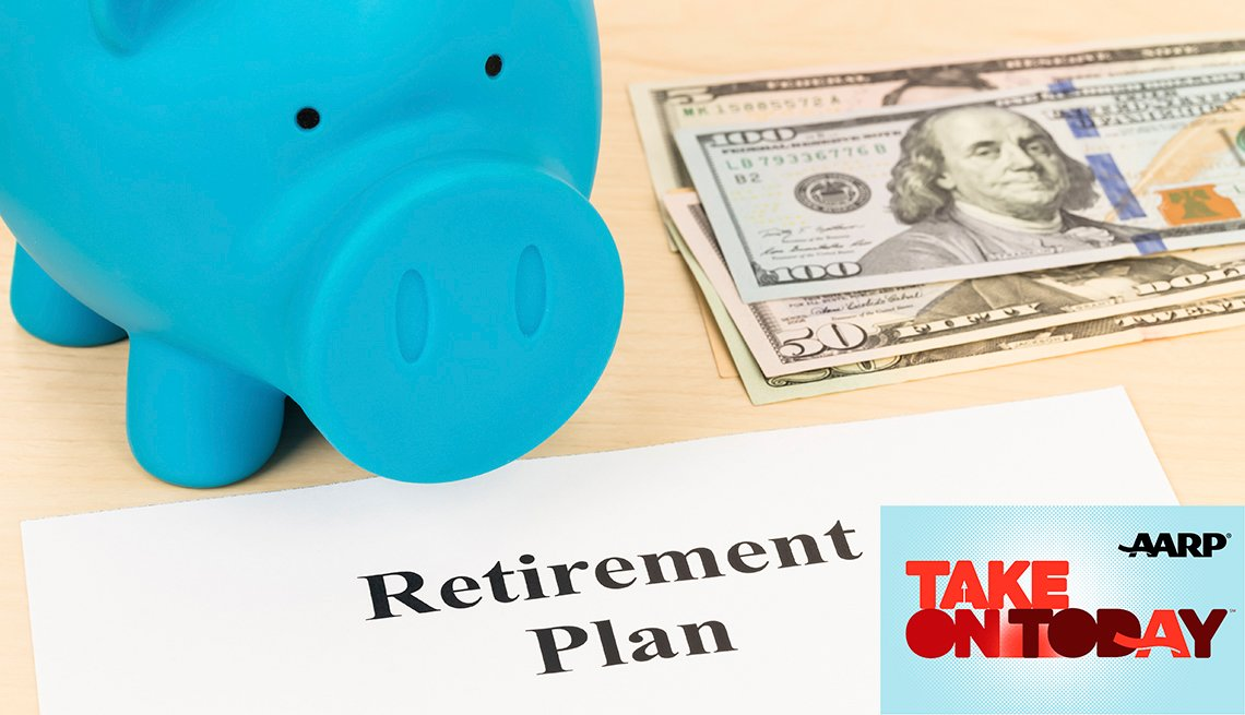 A blue piggy bank sitting in a table with money and a piece of paper that says retirement plan