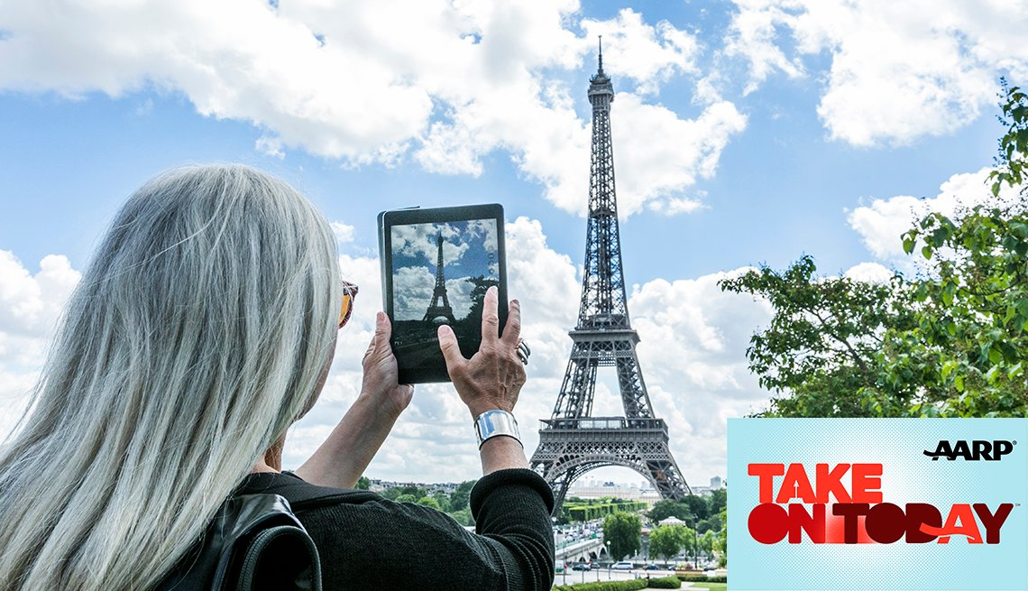Woman taking a picture in Paris