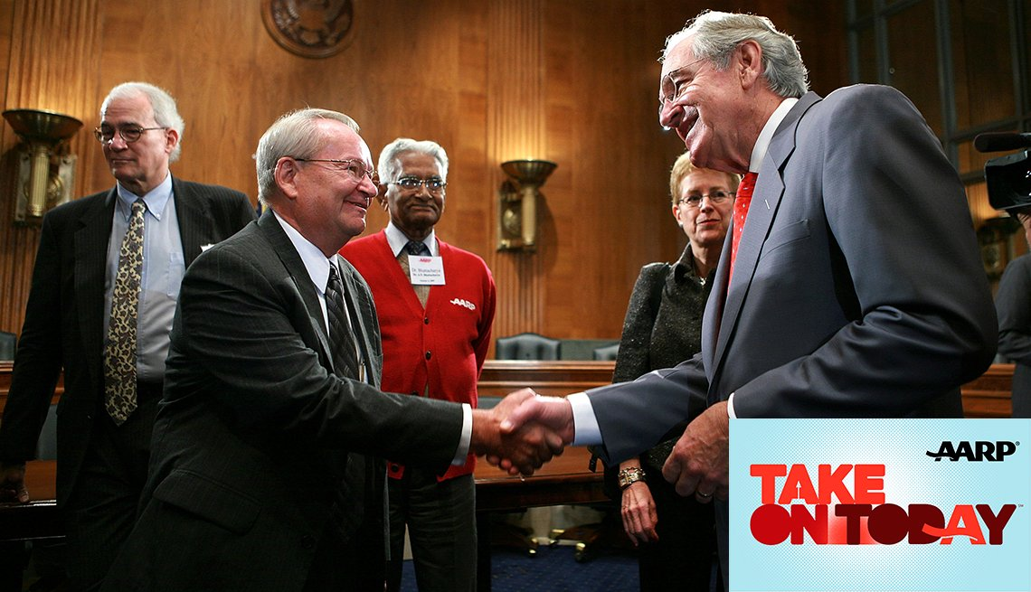 Senator Tom Harkin, right, shakes hands with Jack Gross