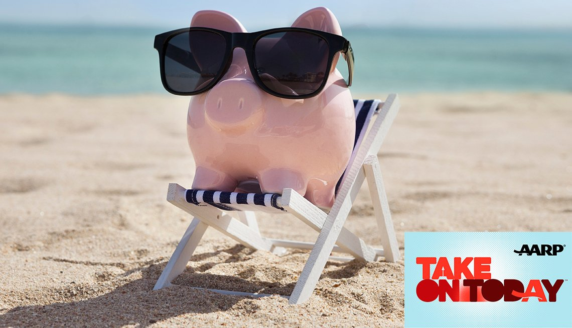 Piggy bank with sunglasses sitting on a beach