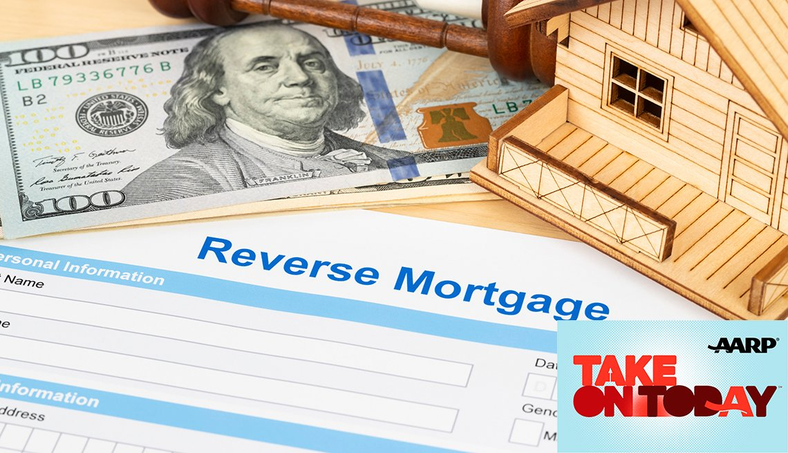 Reverse mortgage paper with money and a house