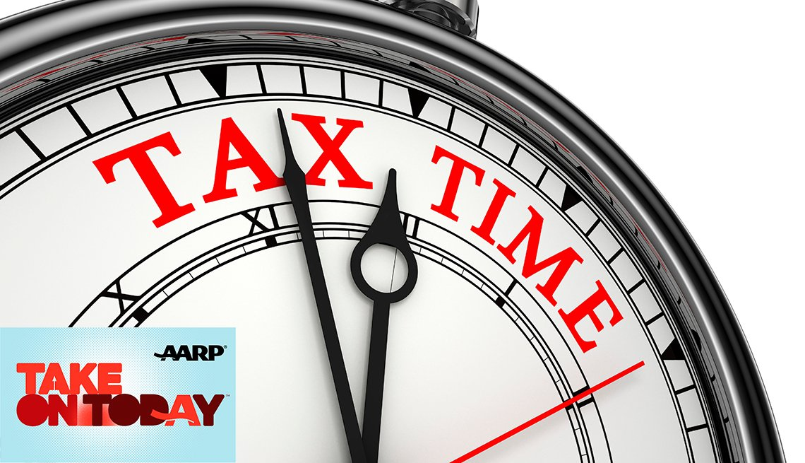 A stop watch with the words tax time in red