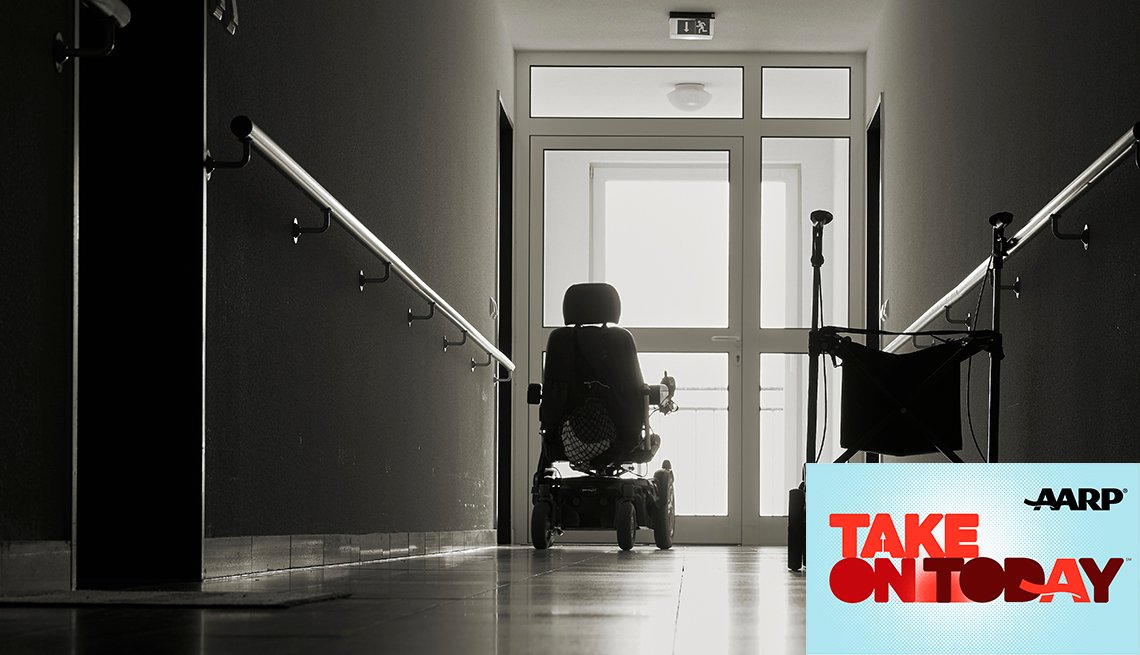 An empty wheelchair and walker in a hallway