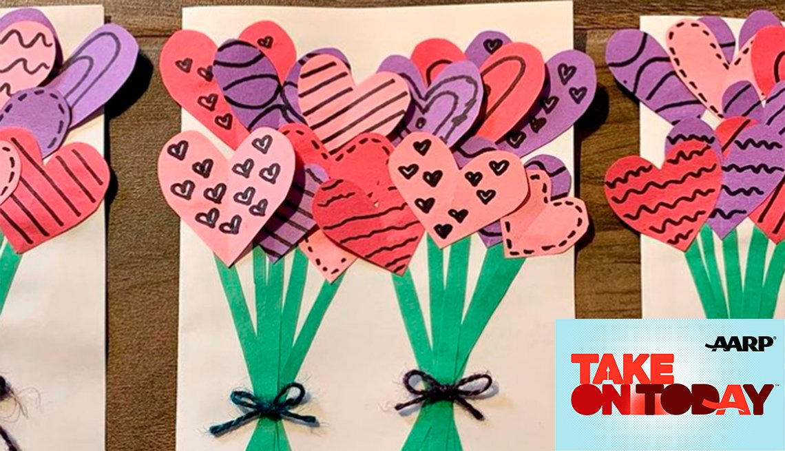 A card with pink purple and red hearts