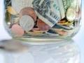 Un frasco con dinero - Su nuevo número de Retiro $58.000