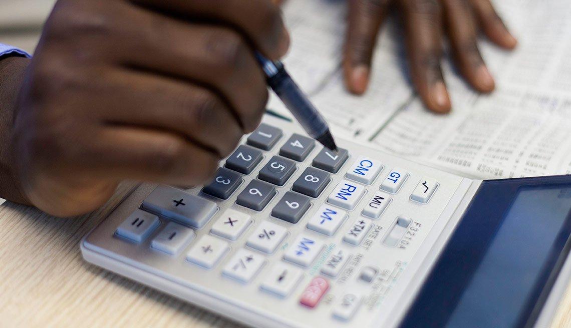 Hands using calculator