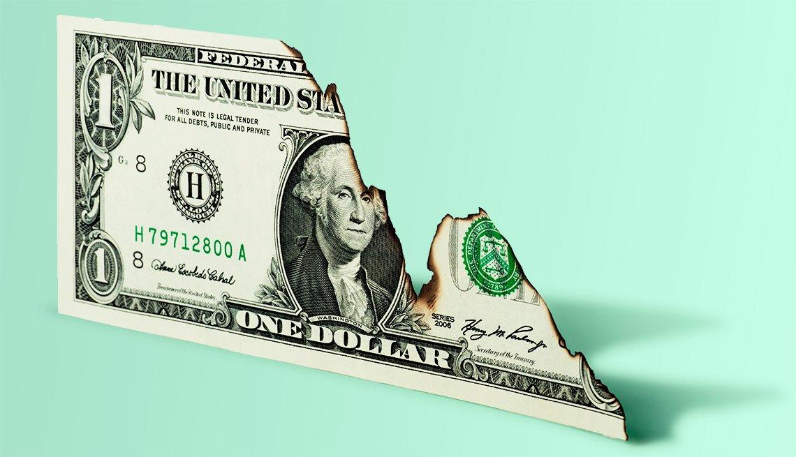 Billete de dólar medio quemado