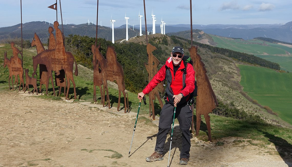 russ eanes stands on the camino de santiago trail with hiking poles