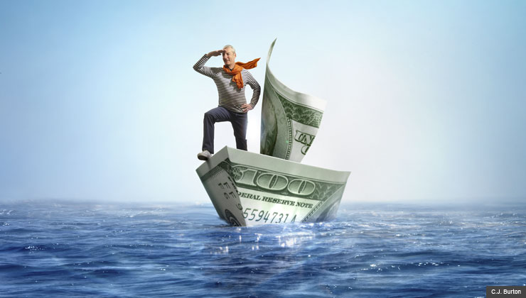 Man sailing waters in small boat made out of money