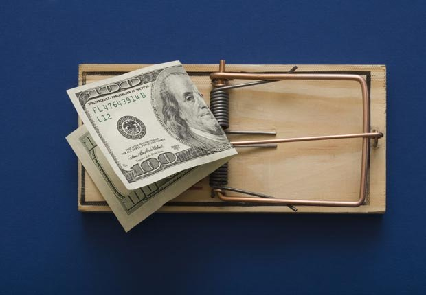 Mouse trap with hundred dollar bill