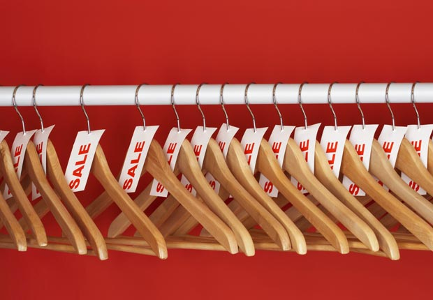Empty clothes hangers with sale tags