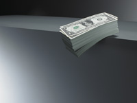 are 401ks a risky investment for retirement?- a pile of cash on the edge of a table