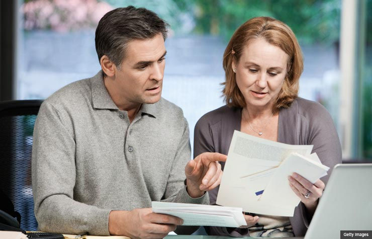 couple paying bills (Getty Images)