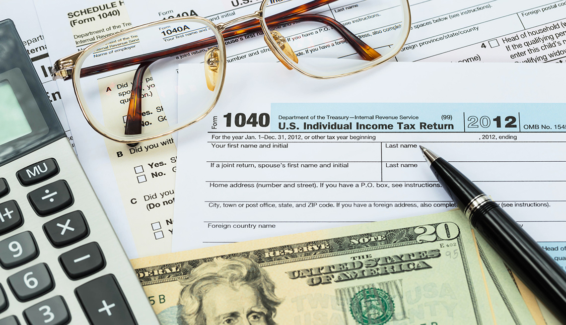 Calculator tax forms cash and eyeglasses